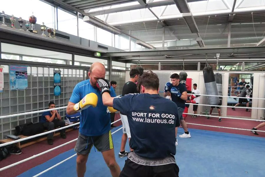 Ron getting hands on at a Laureus project visit in Germany