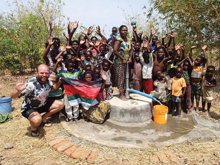 Ron passing through a local community in Malawi.